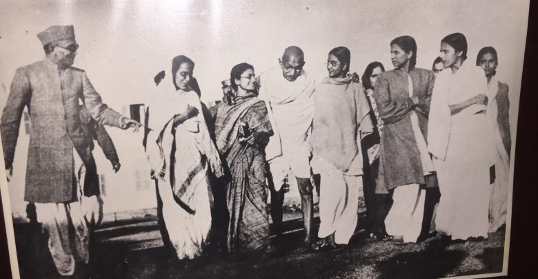 Mahatma Gandhi going with a group of people