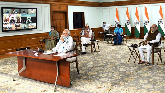 P M Modi holding a meeting